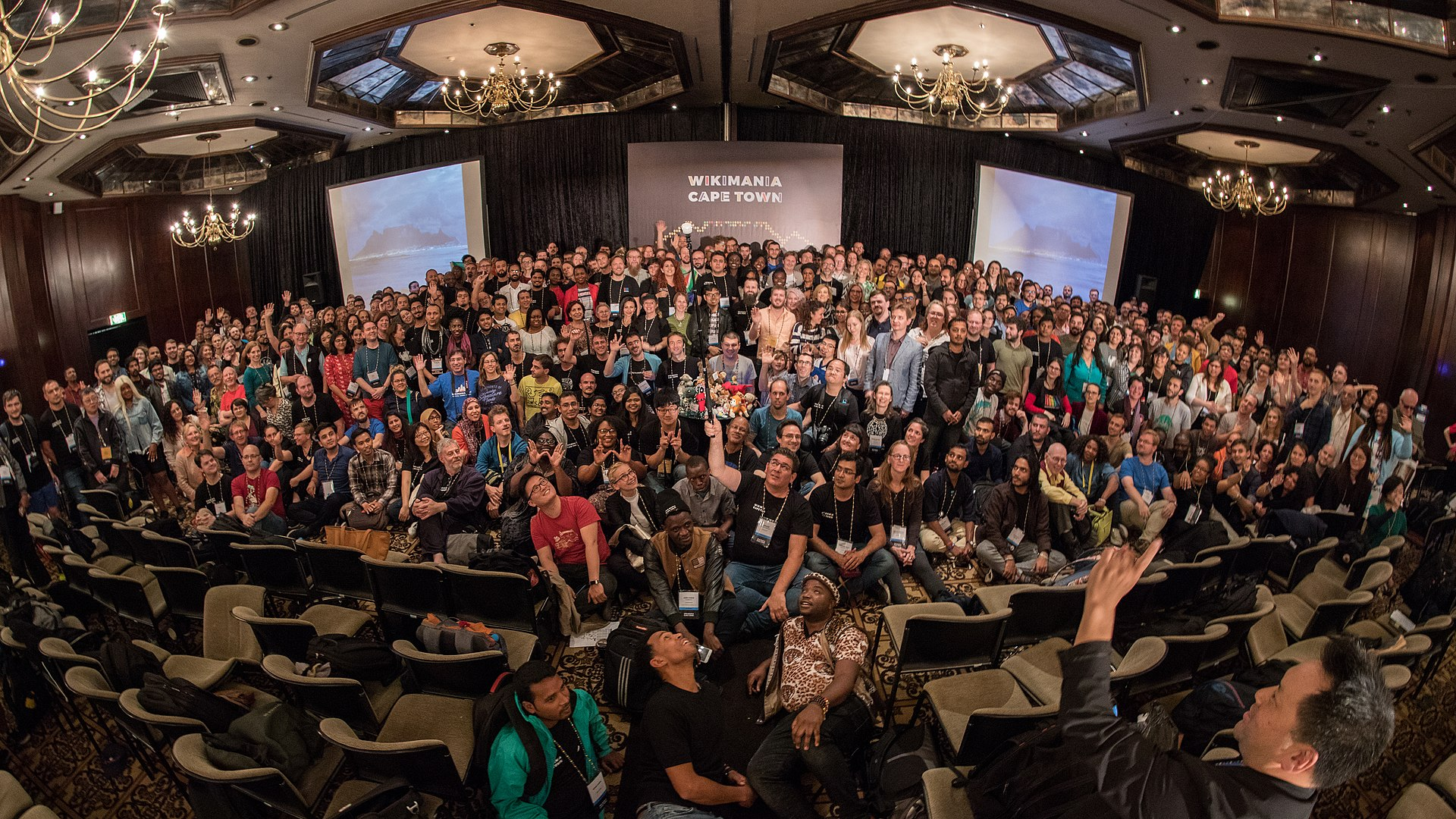 "Martin Kraft (https://commons.wikimedia.org/wiki/File:MJK_26491_Wikimania_2018_group_photo.jpg), ""MJK 26491 Wikimania 2018 group photo"", https://creativecommons.org/licenses/by-sa/3.0/legalcode"